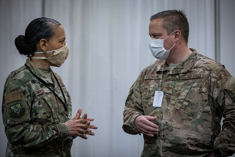U.S. Air Force Col. Yvonne Mays, left, director of staff, New Jersey Air National Guard, speaks with Maj. Justin Krowicki, with the New Jersey Air National Guard's 177th Fighter Wing, at the Federal Medical Station inside the Atlantic City Convention Center, Atlantic City, N.J., April 24, 2020.