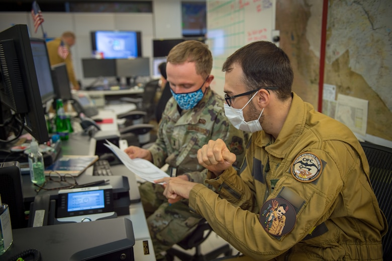 U.S. Air Force 2nd Lt. Kyle Hefner and French Naval Lt. j.g, Octave, targeeteers assigned to the Coalition Intelligence Fusion Cell, 609th Air Operations Center, U.S. Air Forces Central Command, Al Udeid Air Base, Qatar, collaborate daily to provide intelligence support. Targeeters are specially trained to analyze a target and develop solutions to support the commander's objectives