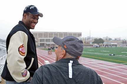 Former San Antonio Spurs center David Robinson speaks with a U.S. Army All-American West Team family member at the Blossom Athletic Center in San Antonio, Dec. 31, 2012.