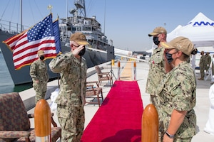 Vice Adm. Jim Malloy, commander of U.S. Naval Forces Central Command, U.S. 5th Fleet and Combined Maritime Forces, left, salutes Cmdr. Samantha A. Dutily, front right, and Capt. William Snyder, back right, during a change of command ceremony for Commander Naval Surface Squadron (CNSS) 5. CNSS 5 serves as the surface type commander's executive agent in Bahrain and provides support to 10 Cyclone-class patrol coastal ships and four Avenger-class mine countermeasures ships in the U.S. 5th Fleet area of operations (AOO). (U.S Navy photo by Mass Communication Specialist 3rd Class Dawson Roth)