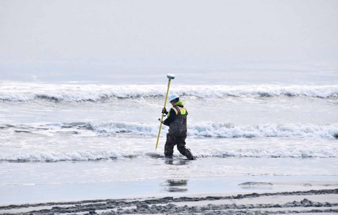A technician conducts survey of the surf zone during 2017 beachfill operations in Avalon.