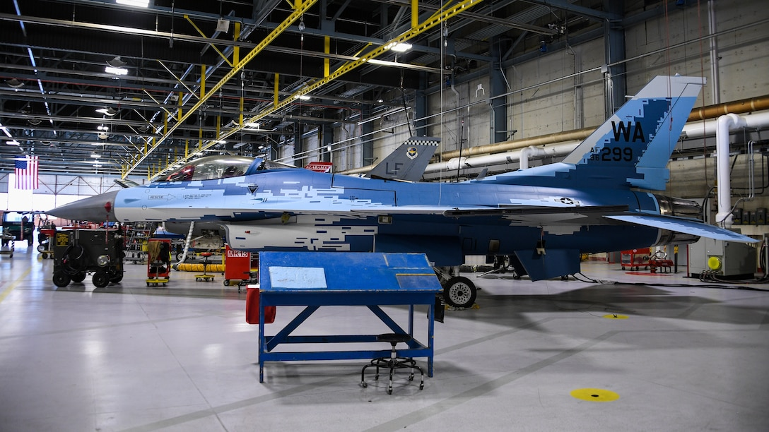 """An F-16 Fighting Falcon with a """"Ghost"""" paint scheme undergoes maintenance at Hill Air Force Base, Utah, May 28, 2020. (U.S. Air Force photo by R. Nial Bradshaw)"""