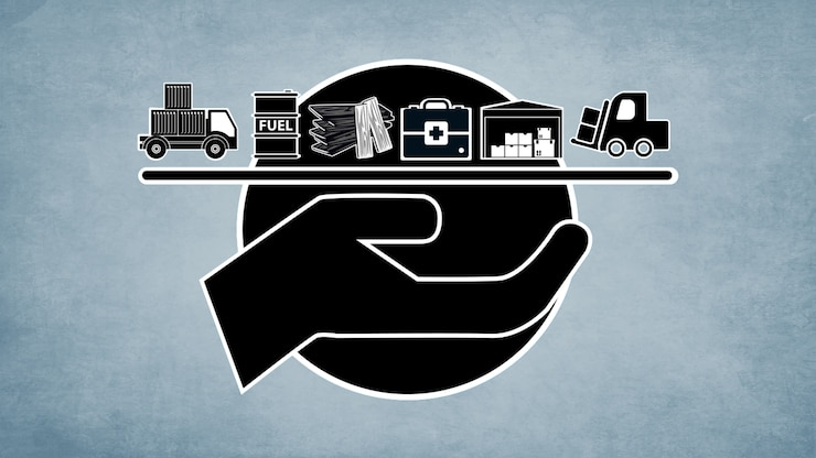 A simplified illustration of a hand holding a tray with a delivery truck, fuel drum, construction materials, medical supplies, storage and a forklift