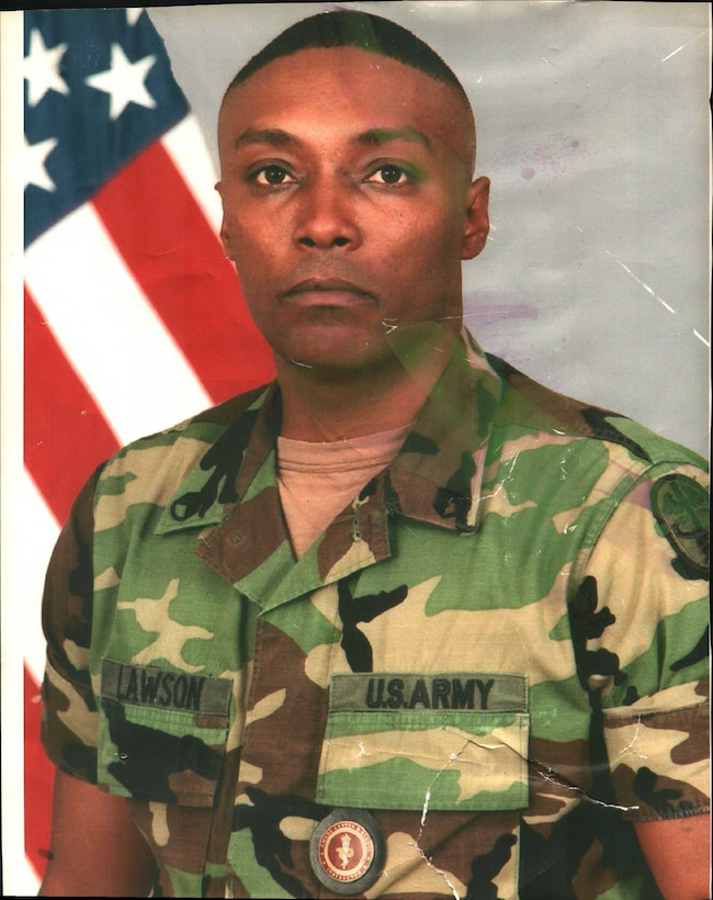 Then, Army Staff Sgt. Bernard Lawson's official photo as an instructor at the Army Medical Department on Fort Sam Houston, Texas, circa 2003. Lawson was recovering from major nerve damage at the Brooke Army Medical Center, when offered an opportunity to teach at AMEDD. Lawson is currently the emergency manager for the Air Force Installation and Mission Support Center. (U.S. Air Force courtesy photo)