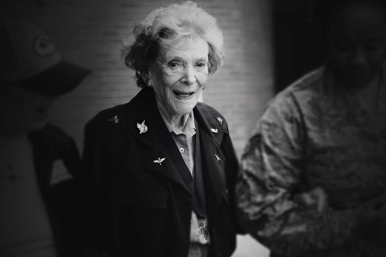 Woman wearing World War II uniform.