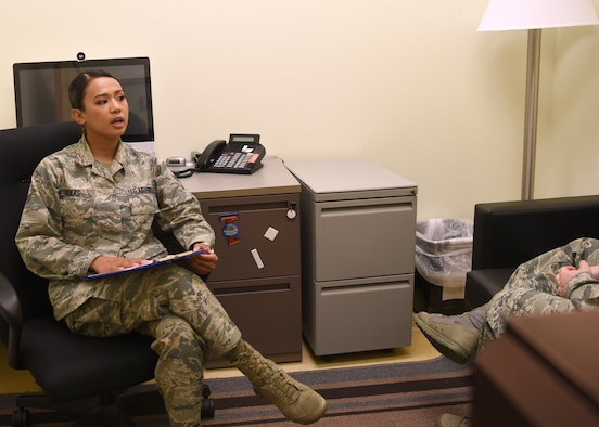 U.S. Air Force Airman 1st Class Alyssa Roxas, 17th Medical Group mental health technician, performs a patient evaluation, with a social distance of six feet away, in the mental health clinic on Goodfellow Air Force Base, Texas, June 5, 2020.  Roxas was trained to schedule new-patient appointments, provide evaluations, administer crisis intervention, perform pre-deployment psychological testing, and address safety concerns. (U.S. Air For photo by Airman 1st Class Abbey Rieves)