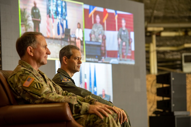 """Gen. Robert """"Abe"""" Abrams, Commander, United Nations Command/Combined Forces Command/United States Forces Korea, and Lt. Gen. Kenneth S. Wilsbach, listen to Gen. CQ Brown, Jr., Commander, Pacific Air Forces, deliver a speech virtually at Osan Air Base, ROK, June 12, 2020. Brown presided over the Seventh Air Force change of command from Wilsbach, to Lt. Gen. Scott L. Pleus. (U.S. Air Force photo by Senior Airman Darien Perez)"""