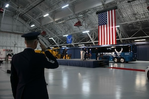 Chief Master Sgt. Harold Kruger, Air Force District of Washington superintendent, salutes the American flag during the playing of the National Anthem at Hangar 3 on Joint Base Andrews, Md., June 11, 2020. This ceremony included the inactivation of the 11th Wing and reactivation of the 316th Wing in addition to the change of command. (U.S. Air Force photo by Airman 1st Class Spencer Slocum)