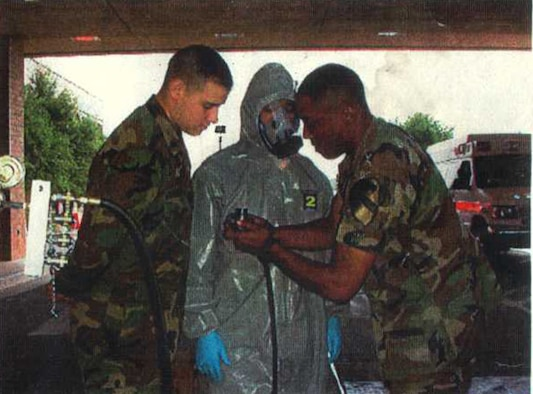 Then, Army Staff Sgt. Bernard Lawson working with a team of CBRN specialist to establish the first patient decontamination team at Brooke Army Medical Center on Fort Sam Houston, Texas, circa 2003. Lawson was at BAMC recovering from major nerve damage to his right side after a routine response call to VX gas at Johnston Atoll, a former chemical, weapons storage and demilitarization site. Through hard work and help from others, like Wounded Warriors, he continues to recover and is currently the emergency manager for the Air Force Installation and Mission Support Center. (U.S. Air Force courtesy photo)
