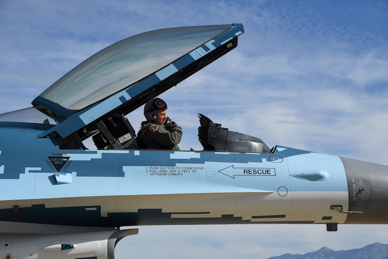 """Lt. Col. Beau Wilkins, 514th Flight Test Squadron, prepares to launch an F-16 Fighting Falcon with a """"ghost"""" paint scheme at Hill Air Force Base, Utah, June 3, 2020. (U.S. Air Force photo by R. Nial Bradshaw)"""
