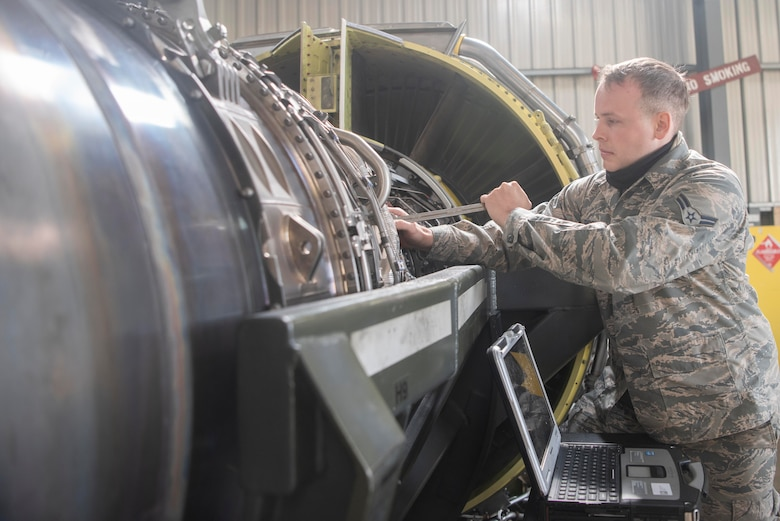 Airman 1st Class Eric Ridout, 100th Aircraft Maintenance Squadron aerospace propulsion apprentice, tightens a bolt on an F108 turbofan engine at RAF Mildenhall, England, June 9, 2020. In addition to repairing engines, the shop conducts periodic maintenance inspections after a certain number of flight hours. (U.S. Air Force photo by Airman 1st Class Joseph Barron)