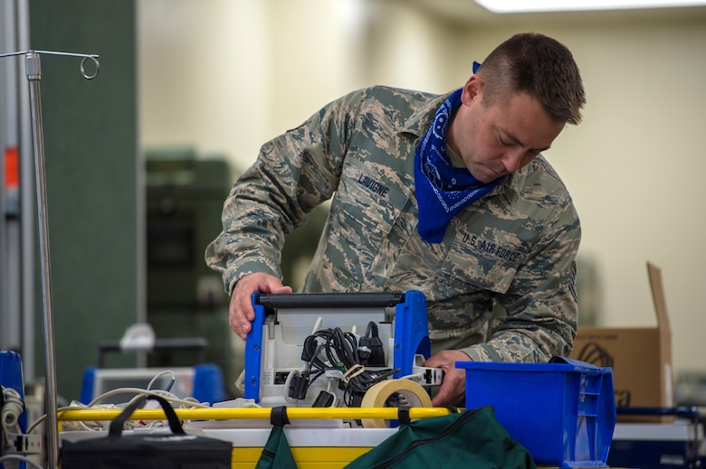 Staff Sgt. Matthew Lavigne, a biomedical equipment technician assigned to the 158th Medical Group, Vermont Air National Guard, inspects medical equipment at the Champlain Valley Exposition Alternate Healthcare Facility, Essex Junction, Vt., May 14, 2020. Lavigne was nominated and selected as the 2019 Air National Guard Medical Services Biomedical Equipment Repair Airman of the Year for this work with the State Partnership Program (SPP) during fiscal year 2019. (U.S. Air National Guard photo by Senior Master Sgt. Michael Davis)