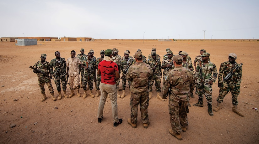 Air Force air advisors assigned to the 409th Expeditionary Security Forces Squadron brief the Niger Armed Forces (FAN) before training exercises in Agadez, Niger, July 10, 2019. The FAN learned how to efficiently and safely clear a building. (U.S. Air Force photo by Staff Sgt. Devin Boyer)