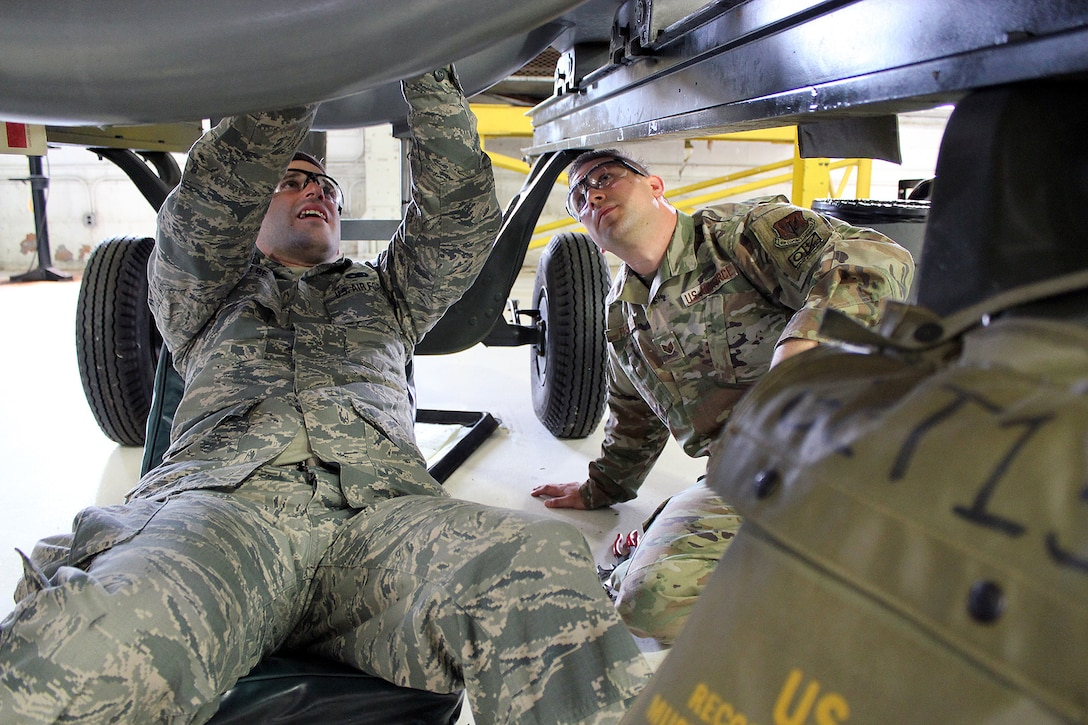 Staff Sgt. Andrew Kolbe works on a T34 engine alongside Staff Sgt. Chris Fisher, at Selfridge Air National Guard Base, Mich., June 6, 2020. The T34 is used on the A-10 Thunderbolt II aircraft assigned to Selfridge. Kolbe was receiving upgrade training as a jet propulsion specialist with the 127th Maintenance Group. (U.S. Air National Guard photo by Tech. Sgt. Dan Heaton)