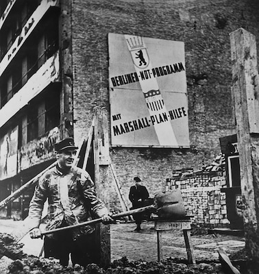 Marshall Plan aid to Germany enabled that country to rise from the ashes of defeat, as symbolized by this worker in West Berlin. (U.S. National Archives)