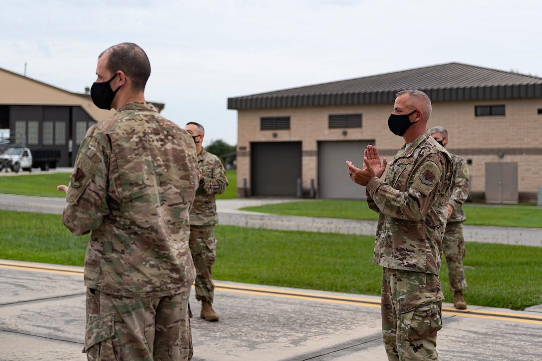 A photo of Airmen applauding Airmen returning from a deployment