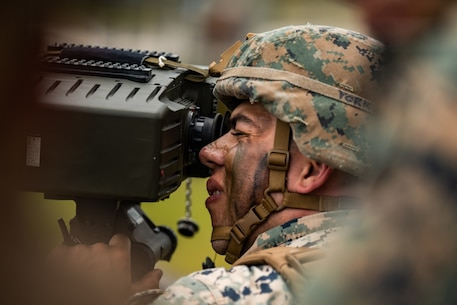 U.S. Marine Corps Cpl. Nicholas York, a Hammond, Indiana native and forward observer with 1st Battalion, 10th Marine Regiment, 2d Marine Division, sights down range during a Battalion Fire Support Coordination Exercise (FSCEX) at Camp Lejeune, North Carolina, June 9, 2020. The Marines conducted a FSCEX to sharpen the skills needed to effectively conduct fire missions using mortars, artillery, and aircraft in preparation for future deployments. (U.S. Marine Corps photo by Lance Cpl. Patrick King)