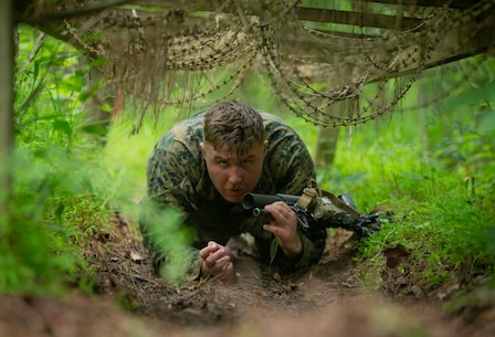 U.S. Marine Corps Lance Cpl. Charles Megown, a rifleman with 2d Light Armored Reconnaissance Battalion (LAR) participates in an endurance course during the Isaak Competition at Camp Geiger, North Carolina, June 8, 2020. 2d LAR hosts the annual competition to honor Cpl. Garreth Isaak, a LAR Marine who earned the Silver Star during Operation Just Cause. It aims to develop the unit's combat fitness, proficiency, readiness, and recognize the most proficient scout within the Battalion. (U.S. Marine Corps photo by Cpl. Alize Sotelo)