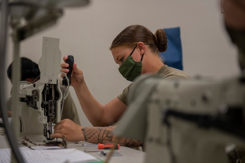 Aircrew Flight Equipment student replaces the feed dog on a 206RB Consew sewing machine