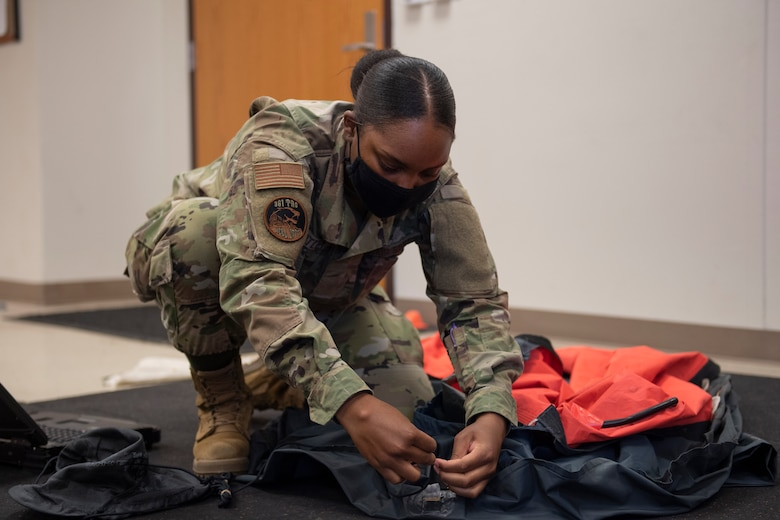Aircrew Flight Equipment student works on life raft