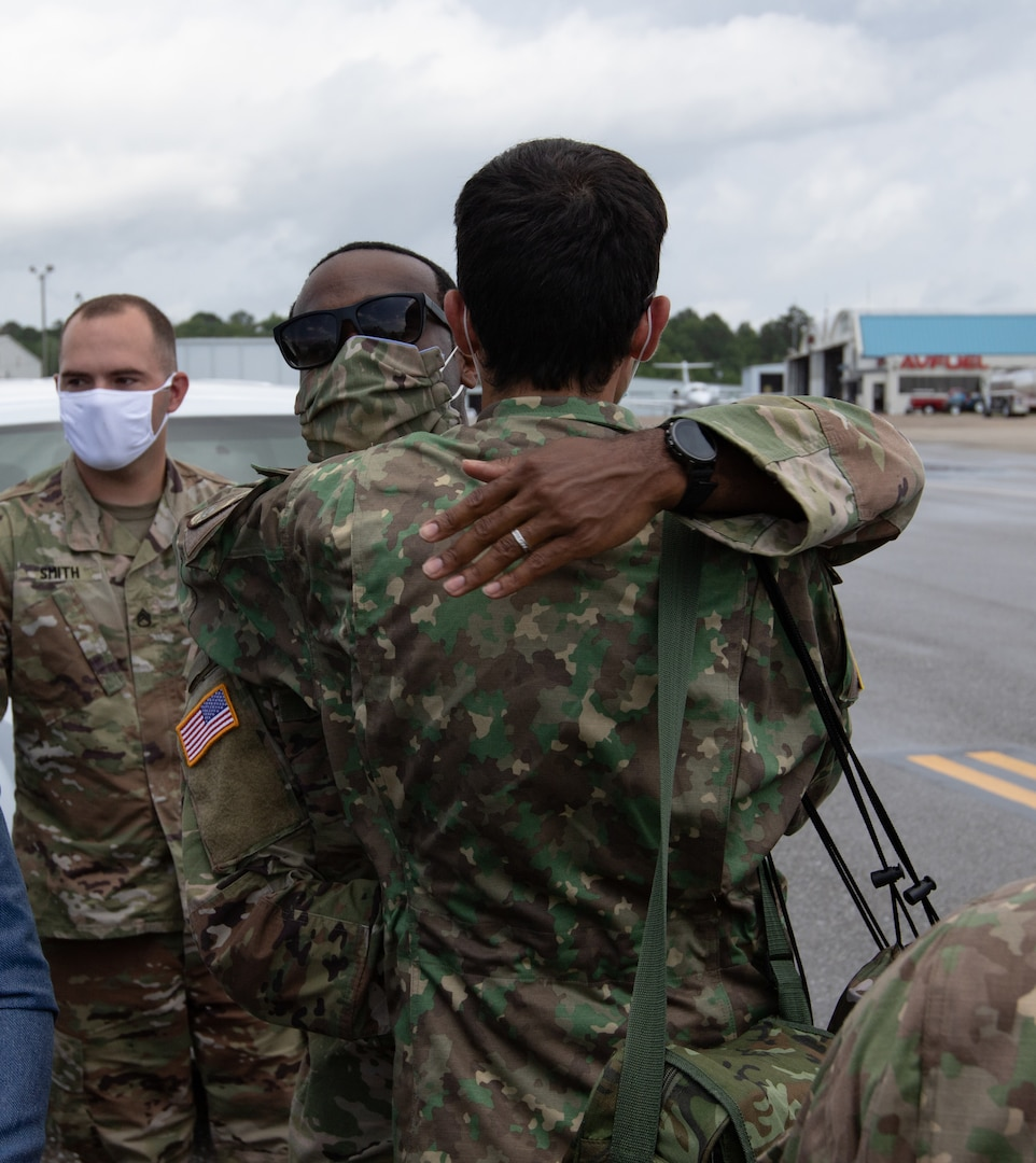 Members of the Romanian delegation say goodbye to their Alabama National Guard counterparts before boarding their plane to fly home from Montgomery, Alabama, June 9, 2020.  The visit was part of the National Guard Bureau's State Partnership Program which allows for the exchange of knowledge and experience between the Alabama National Guard and the Romanian Ministry of Defense.