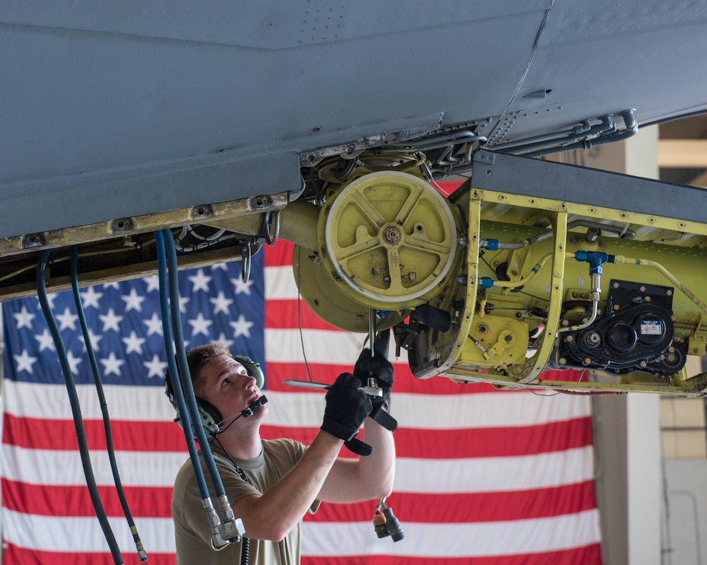 Staff Sgt. Alex Comfer, 914th Maintenance Squadron hydraulics technician, prepares to remove the bolt that holds the boom arm in place on a KC-135R Stratotanker aircraft at Niagara Falls Air Reserve Station, N.Y., June 5, 2020. Maintainers are required to perform extensive periodic inspections on all aircraft, which can last for several weeks. (U.S. Air Force photo by Peter Borys)