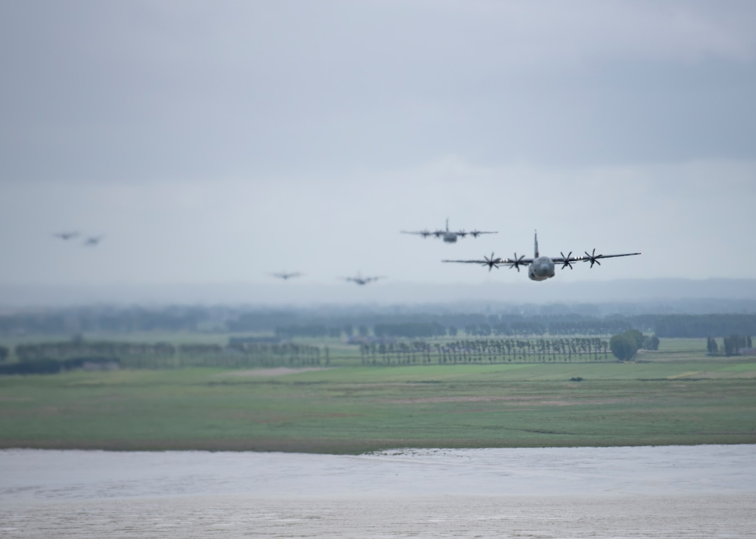 A C-130J Super Hercules flies through French airspace June 6, 2020. To commemorate the 76th anniversary of D-Day, eight C-130J aircraft from the 37th Airlift Squadron at Ramstein Air Base, Germany, performed low-level formations over several different locations in France. (U.S. Air Force photo by Staff Sgt. Kirsten Brandes)