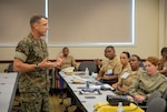 Marine Corps Brig. Gen. Francis L. Donovan, assistant commander for operations, Special Operations Command Korea,  addresses attendees on operations and intel briefs during the 47th annual National Naval Officers Association (NNOA) symposium at Admiral Kidd Catering and Conference Center in San Diego