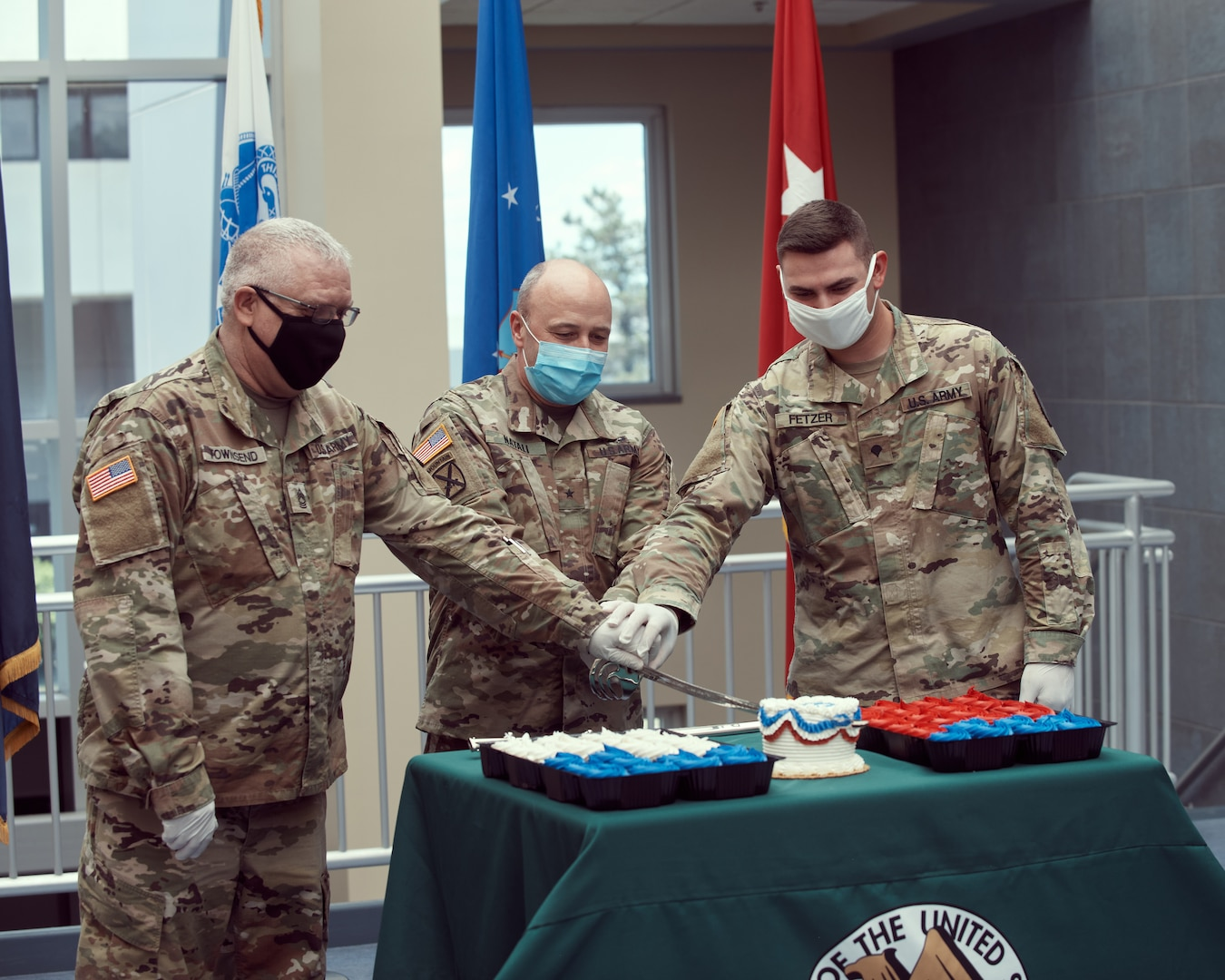 Master Sgt. Roger Townsend, an IT specialist assigned to New York National Guard Joint Force Headquarters, Brig. Gen. Michel Natali, the assistant adjutant general, Army, and Spc. Charles Fetzer, a military policeman assigned to the 104th Military Police Battalion, cut the U.S. Army birthday cake during a 245th Army birthday celebration at the Division of Military and Naval Affairs, Latham, N.Y., June 12th, 2020. The Army birthday is recognized each year with a cake cutting featuring the youngest Soldier, representing the future; the oldest Soldier representing wisdom and traditions; along with the commanding officer, though this year COVID-19 precautions were in place limiting the size of the event.