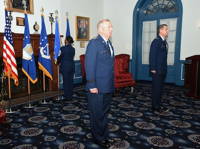 U.S. Air Force Chief Master Sgt. Christy Peterson, 11th Wing command chief, posts the 11th Wing flag while U.S. Air Force Maj. Gen. Ricky Rupp, Air Force District of Washington commander, and U.S. Air Force Col. Mike Zuhlsdorf, 11th Wing and Joint Base Anacostia-Bolling commander, stand at attention during the wing activation and assumption-of-command ceremony on Joint Base Anacostia-Bolling, Washington D.C., June 12, 2020. The 11th Wing -- The Chief's Own was activated on the base in preparation for assuming host-wing responsibilities. The base will officially transfer from Navy to Air Force responsibility in October 2020. (U.S. Air Force photo by 1st Lt. Kali L. Gradishar)