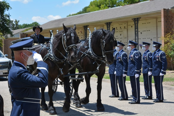 Members of Dyess Air Force Base Honor Guard prepare to render honors for retired Col. Sam Johnson during his funeral on June 8, 2020 at Restland Funeral Home in Dallas, Texas.