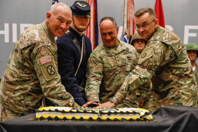 The U.S. Army Central command team, the youngest USARCENT Soldier, and oldest USARCENT Soldier, cut the birthday cake for the 245th U.S. Army birthday observance, Shaw Air Force Base, S.C., 11 Jun. 2020. Soldiers from the headquarters portrayed Medal of Honor recipients and spoke on their accomplishments.  All COVID-19 guidelines were followed, and the audience maintained social distancing.