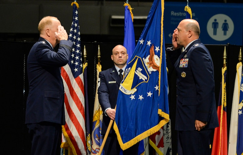 U.S. Air Force Col. Patrick Miller, assumes command of the 88th Air Base Wing from Lt. Gen. Robert McMurry, Air Force Life Cycle Management Center commander, during a change of command ceremony inside the National Museum of the United States Air Force at Wright-Patterson Air Force Base, Ohio, June 12, 2020. Col. Miller replaced Col. Thomas Sherman. This year's change of command ceremony was different from years past with no more than 50 people in attendance but instead broadcasted live over social media and no contact between principles due to the COVID-19 pandemic. (U.S. Air Force photo by Wesley Farnsworth)