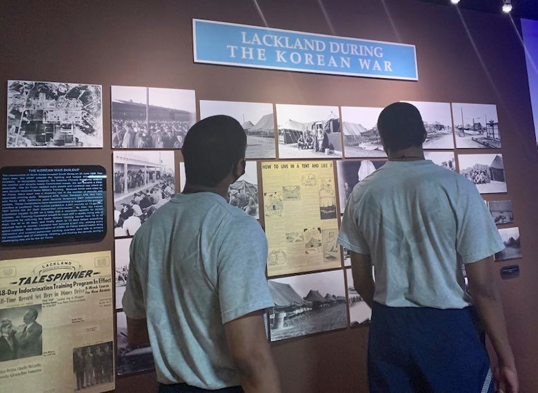 Photo of basic military training trainees viewing Airman Heritage Museum exhibits.