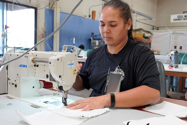Shop 64A Fabric Worker manufactures a safety covering to be distributed to the workforce.