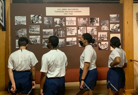 Photo of basic military training trainees at exhibits the Airman Heritage Museum.