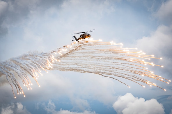 Airmen assigned to the 347th Rescue Group drop flares from an HH-60G Pave Hawk during a fini flight for Col. Bryan Creel, 347th RQG commander at Moody Air Force Base, Ga., June 5, 2020. The fini flight is a long-standing Air Force tradition that occurs when a pilot departs from an assigned unit. (U.S. Air Force photo by Senior Airman Hayden Legg)