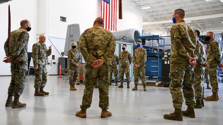 Gen. Bunch is addressing Airmen standing in an aircraft maintenance hangar from the 309th Expeditionary Depot Maintenance Flight.