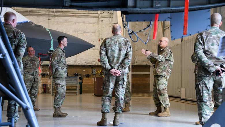 Gen. Bunch speaks with Airmen in an aircraft maintenance hangar from the 309th Expeditionary Depot Maintenance Flight.