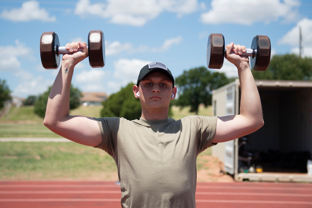An Airman works out at a fitness pod