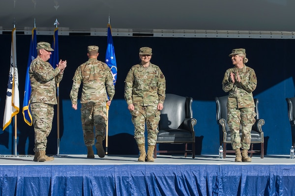 Lt. Gen. Brad Webb, the Air Education and Training Command commander (left), and Brig. Gen. Laura Lenderman, the former 502d Air Base Wing and Joint Base San Antonio commander (right), congratulate Brig. Gen. Caroline Miller, the wing's newest commander, during a change of command ceremony June 12 at JBSA-Fort Sam Houston.