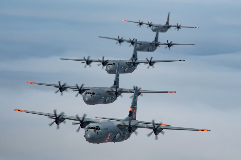 5 (of 6) California Air National Guard C-130J Super Hercules aircraft fly in tight formation over the Pacific Ocean, California. May 27, 2020. California Air National Guard maintainers from the 146th Maintenance Group and aircrew from the 115th Airlift Squadron, collaborated to accomplish the launching of 6 C-130J Super Hercules aircraft for the first time in over 20 years U.S. Air National Guard by Tech. Sgt. Nieko Carzis.