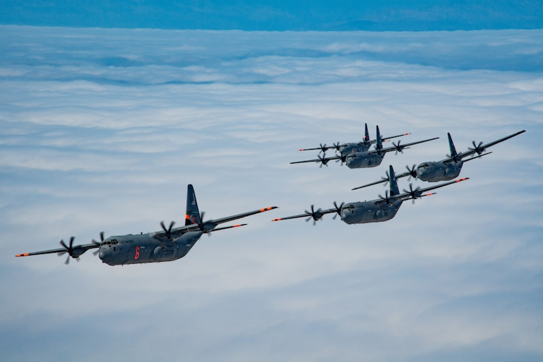 5 of 6 California Air National Guard C-130J Super Hercules aircraft fly in tight formation over the Pacific Ocean, California. May 27, 2020. California Air National Guard maintainers from the 146th Maintenance Group and aircrew from the 115th Airlift Squadron, collaborated to accomplish the launching of 6 C-130J Super Hercules aircraft for the first time in over 20 years U.S. Air National Guard by Tech. Sgt. Nieko Carzis.