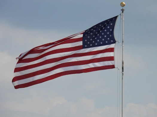 The United States flag flying in front of Bldg. 3001 at Tinker Air Force Base, Oklahoma. (Air Force photo by April McDonald)