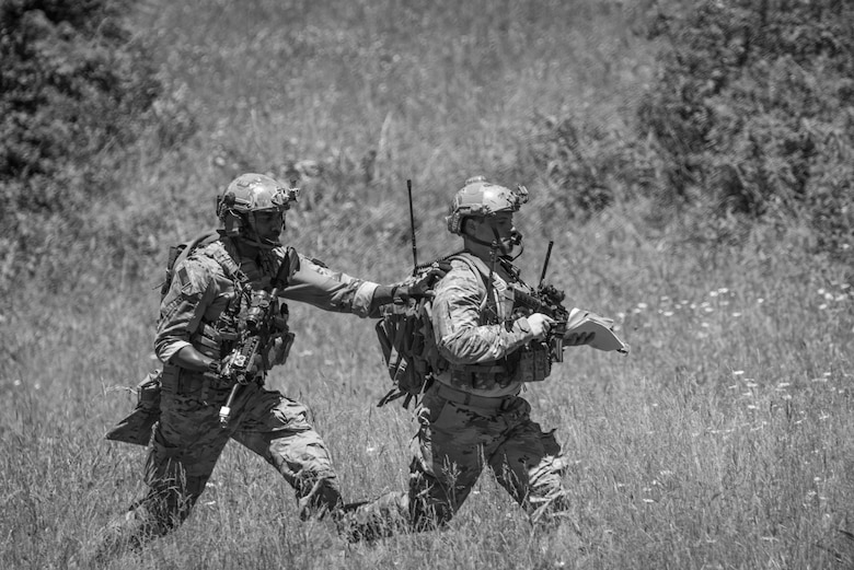 U.S. Air Force Staff Sgt. Kerry Martin, left, and Senior Airman Anthony Severo, both Joint Terminal Attack Controllers from the 148th Air Support Operations Squadron, Pennsylvania Air National Guard, bound to their next objective during a training exercise, June 13, 2020, in Annville, Pennsylvania.
