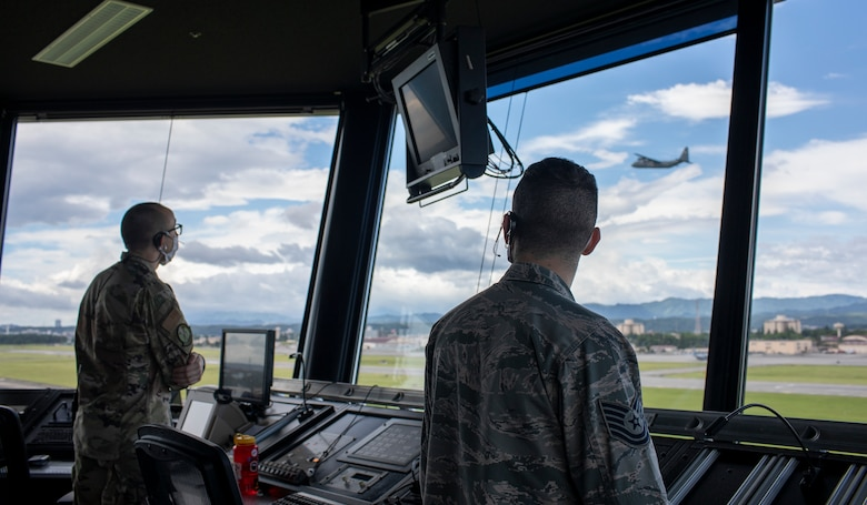 Tech. Sgt. Gregory Nitch and Staff Sgt. Grant Krause, both with the 374th Operations Support Squadron air traffic controllers,