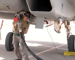 U.S. Air Force Senior Airman, Timothy Reeves, 44th Expeditionary Fighter Squadron crew chief, refuels an F-15C Eagle during an integrated combat turn at Prince Sultan Air Base, Kingdom of Saudi Arabia on June 6, 2020. The rapid re-arming and refueling of the Eagle also known as an integrated combat turn is a  platform geared to reduce the pilot's ground time and quickly resume air dominance.(U.S. Air Force photo by Staff Sgt. Amanda Stanford)