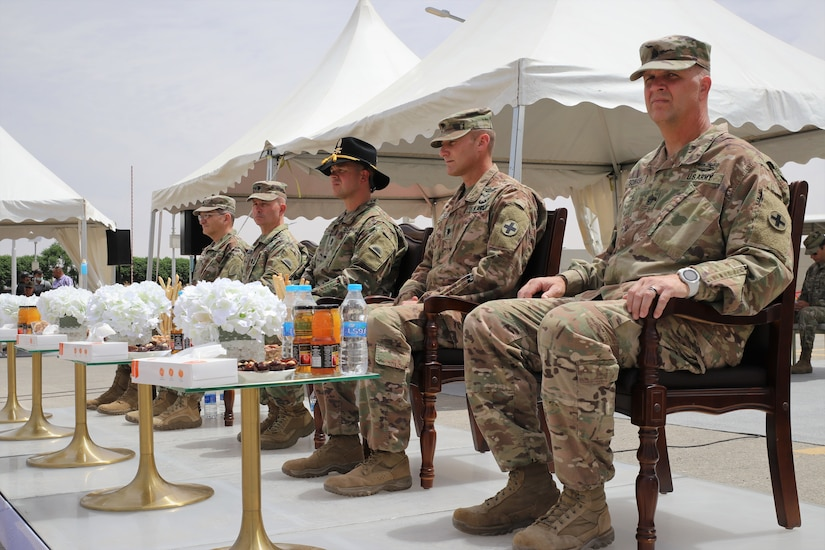 From left to right: Col. David Kobs, the Defense Attaché at the U.S. Embassy in Amman, Jordan, Lt. Col. Timothy Ozmer, Commander of the 1st Squadron, 303rd Cavalry Regiment (1-303 CAV), Cmd. Sgt. Maj. John Hurt of the 1-303 CAV, Lt. Col. Gregory Settle, Commander of the 2nd Battalion, 130th Infantry Regiment (2-130 IN), and Cmd. Sgt. Maj. Jeffrey Sowash of the 2-130 IN.
