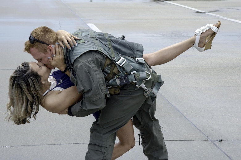 Photo of a pilot kissing his wife.