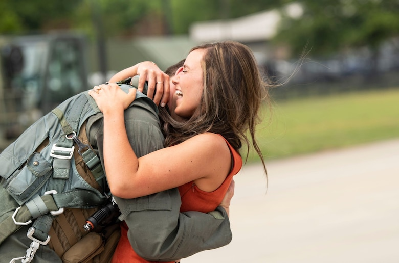 Photo of a pilot embracing his wife.